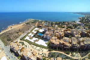 Buy a modern apartment on tne first line. Punta Prima. Orihuela Costa.